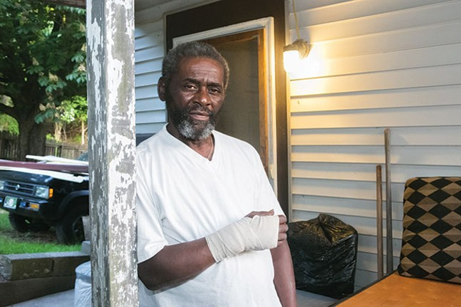 Jayvan Tarver in front of his home in Garfield - CP PHOTO BY JOHN COLOMBO