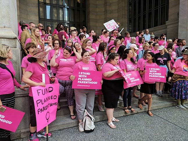 """Pink Out"" rally at the City-County Building Downtown - CP PHOTO BY REBECCA ADDISON"
