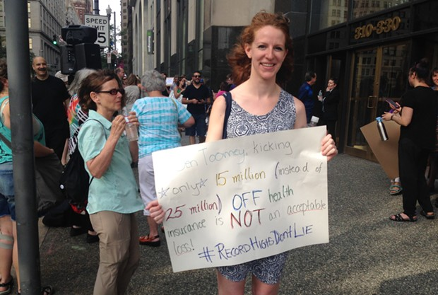 Allegheny General Hospital nurse Caitlyn Fitzsimmons at a June 22 rally in Downtown. - CP PHOTO BY RYAN DETO