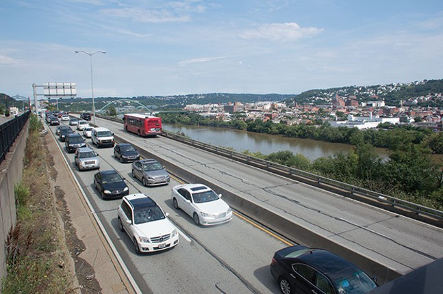 Drivers head west on Boulevard of the Allies during rush hour in the daily exodus of cars out of Pittsburgh. - CP PHOTO BY JORDAN MILLER