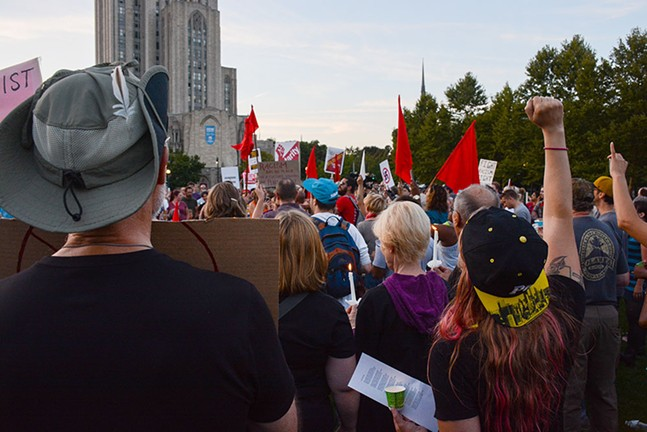 """The crowd sang the 19th century socialist anthem """"The Red Flag"""" to the tune of """"O Christmas Tree"""" during a candlelight vigil in Schenley Plaza on Sun., Aug. 13. - CP PHOTO BY STEPHEN CARUSO"""