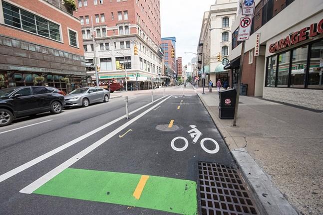 A protected bike-lane cycletrack on Penn Avenue, Downtown - CP PHOTO BY JAKE MYSLIWCZYK
