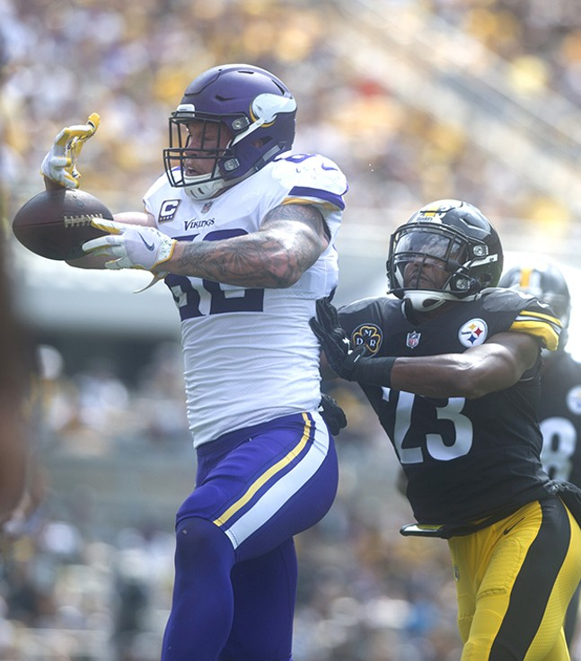 Vikings Kyle Rudolph is hit by Steelers safety Mike Mitchell while he tries to bring in a catch.