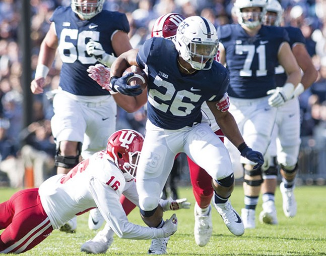 Saquon Barkley tries to break a tackle Sept. 30 against Indiana at Penn State's Beaver Stadium - PHOTO COURTESY OF CAMILLE STEFANI/THE DAILY COLLEGIAN