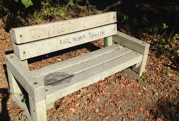 "A park bench on the North Side Three Rivers Heritage Trail has been vandalized with the words ""Kill Niger Tomlin."" - CP PHOTO BY RYAN DETO"