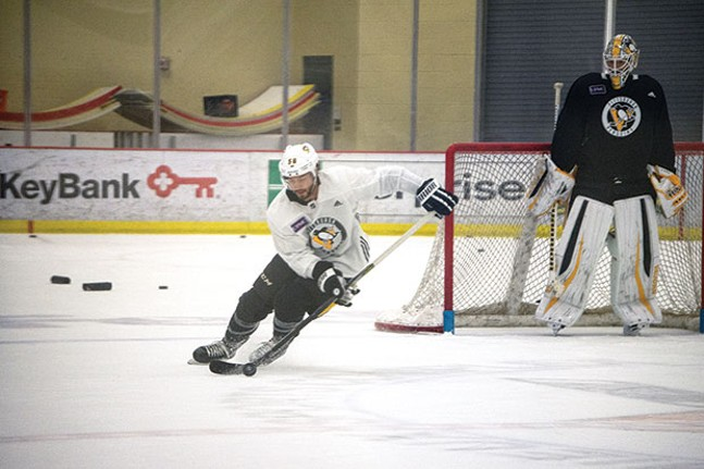 Kris Letang and Matt Murray during practice at UPMC Lemieux Sports Complex - CP PHOTO BY JAKE MYSLIWCZYK
