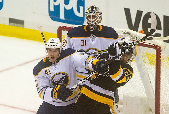 Carl Hagelin battles with Buffalo Sabres Justin Falk in front of the Sabres net. - CP PHOTO BY VINCENT PUGLIESE