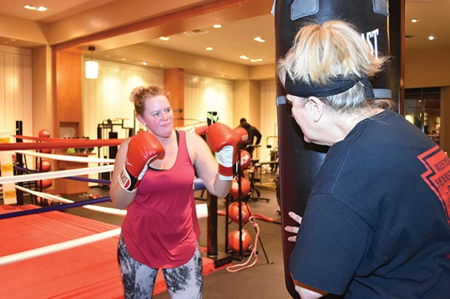 Gloria Sztukowski (right) trains with a new member. - CP PHOTO BY JAKE MYSLIWCYZK