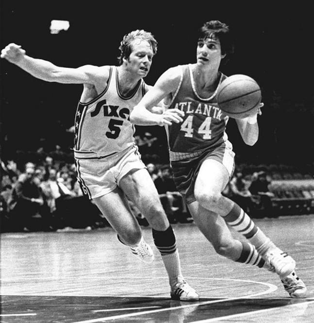 Pistol Pete Maravich, right, drives to the basket past Philadelphia's Tom Van Arsdale in 1974.