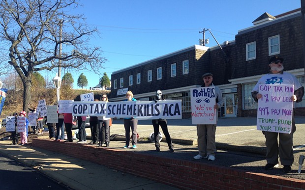 Protesters outside of U.S. Rep. Keith Rothfus' office in Ross on Nov. 29. - CP PHOTO BY RYAN DETO
