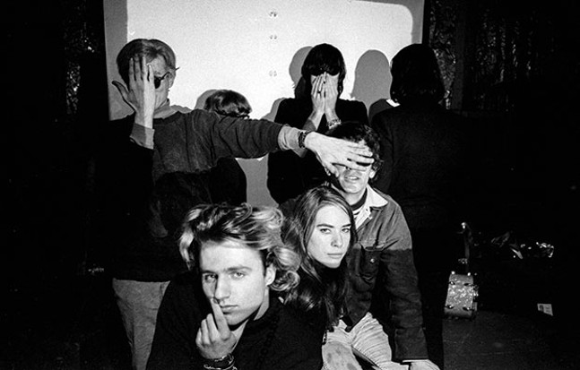 """""""Group Shot"""" with Andy Warhol (at left) and Factory habitués - IMAGE: ©ESTATE OF NAT FINKELSTEIN"""