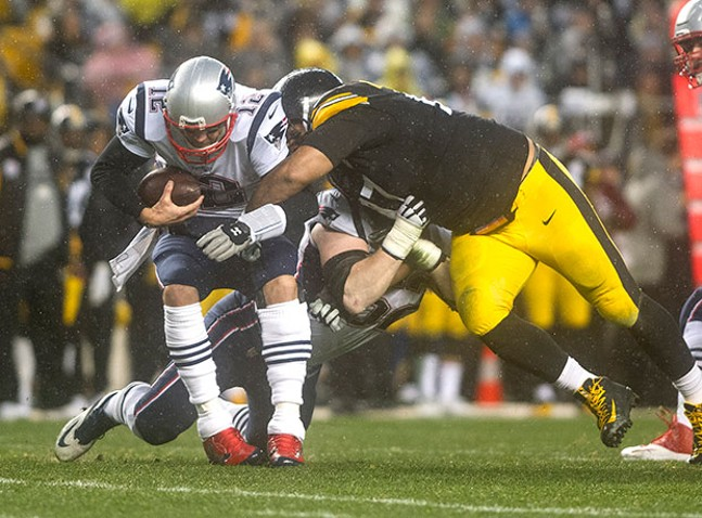 Steelers Cameron Heyward sacks Patriots Tom Brady.