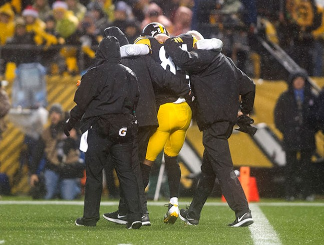 Antonio Brown is helped off of the field after the injury. Brown didn't return to the game.