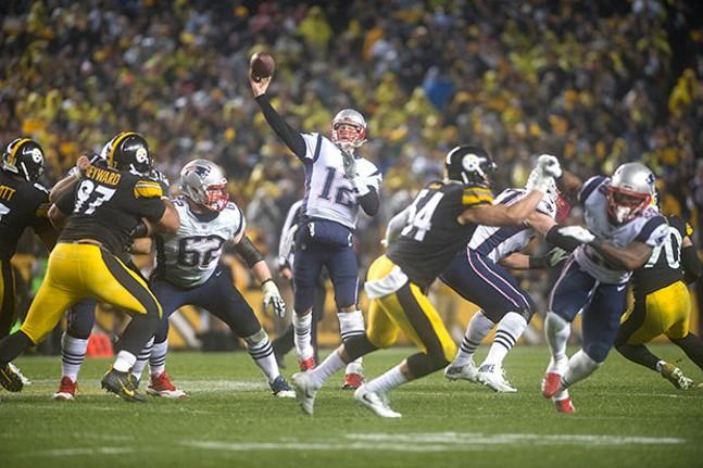 Patriots quarterback Tom Brady throws a deep pass down the sideline during the second quarter.
