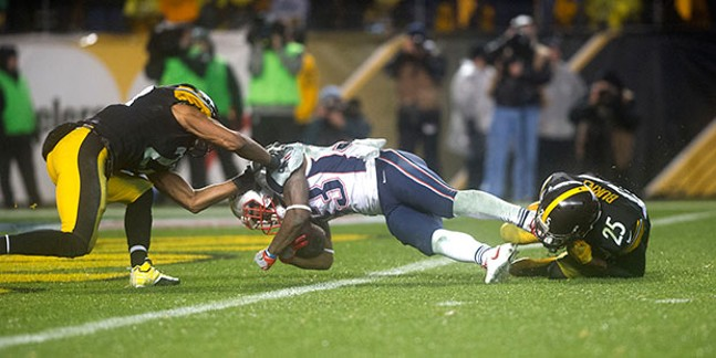 Patriots Dion Lewis dives into the end zone for the touchdown that put the Patriots ahead late in the fourth quarter.
