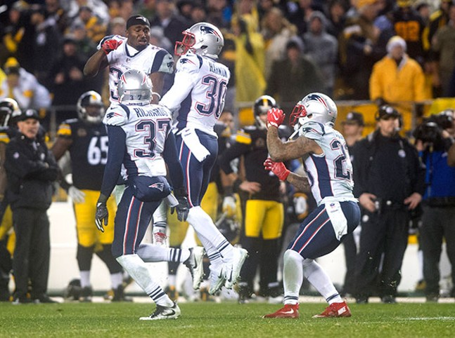 The New England Patriots defense celebrates their improbable victory over the Steelers.