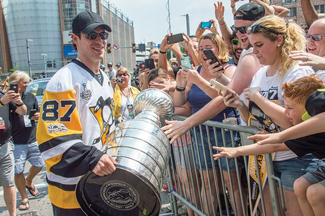 Sidney Crosby holds the Stanley Cup during the Pens second consecutive Stanley Cup victory parade. - CP PHOTO BY JORDAN MILLER