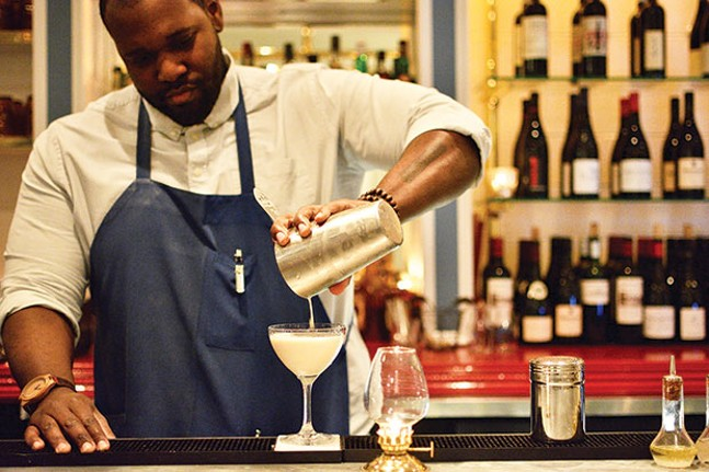 Cecil Usher prepares a Brandy Alexander behind the bar at Poulet Bleu. - CP PHOTO BY KATE HAGERTY
