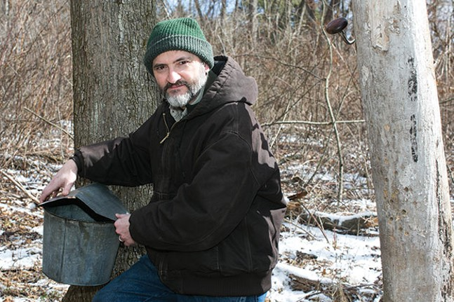 Scott Detwiler with a maple-syrup tap bucket - CP PHOTO BY JOHN COLOMBO