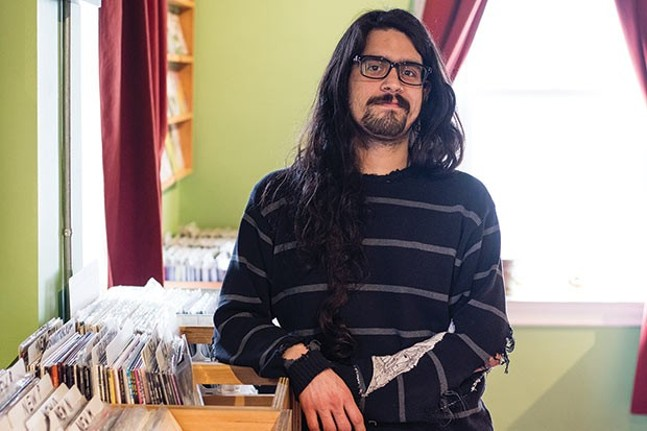 John Villegas at his music store Cruel Noise Records in Polish Hill. - CP PHOTO BY LUKE THOR TRAVIS