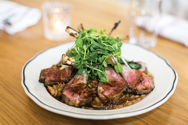 Rack of lamb with mushroom risotto, peashoots and grilled ramp salad from The Whitfield's lamb menu - CP PHOTO BY JOHN COLOMBO