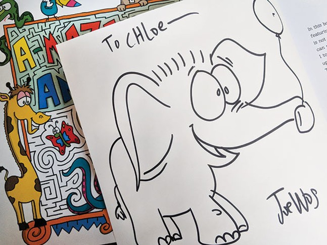 A signed copy of Pittsburgh artist Joe Wos' A-Maze-Ing Animals - CP PHOTO BY LISA CUNNINGHAM