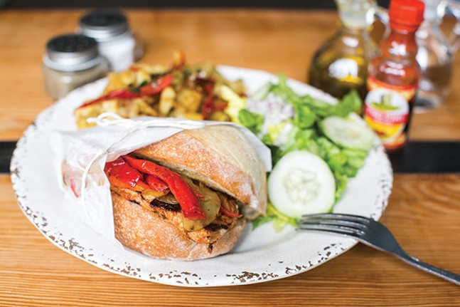 Bifana: pork loin with sautéed onions, lettuce and tomato in a garlic sauce on a Portuguese roll; served with imported peppers, Portuguese salad and home fries - CP PHOTO BY JOHN COLOMBO