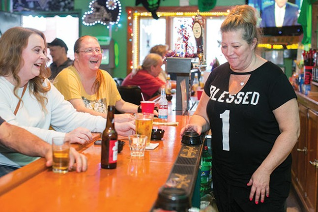Wendy Yurok shares a laugh with customers at Kelly's Korner Bar. - CP PHOTO BY JOHN COLOMBO