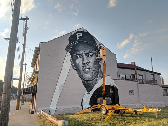 Jeremy Raymer at work on his Clemente mural - CP PHOTO BY LISA CUNNINGHAM