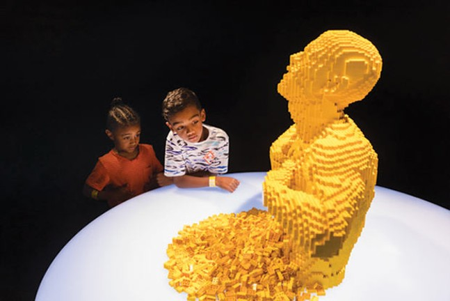 "Children marvel at ""Yellow,"" a Lego sculpture by Nathan Sawaya, at The Art of the Brick at the Carnegie Science Center's new PPG Science Pavilion - PHOTO COURTESY OF RENEE ROSENSTEEL"