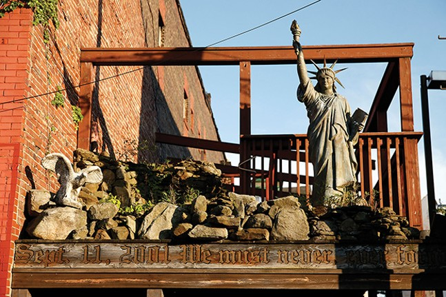 A September 11 memorial sits on Emlin Street behind the businesses along East Ohio Street.
