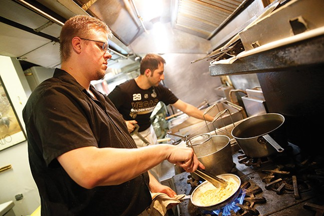 Chef John Gault prepares fettuccini Alfredo at Legends of the North Shore. - CP PHOTO BY JARED WICKERHAM