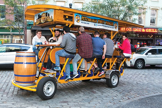 The Party Pedaler drives through Market Square. - CP PHOTO BY JOHN COLOMBO