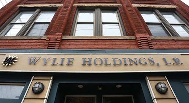 Wylie Holdings has cashed in on Lawrenceville's revitalization, but is it being a good neighbor?