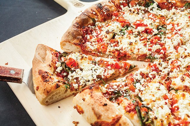 Florentine pizza: spinach, garlic, diced tomatoes, ricotta and feta cheese with a light marinara sauce