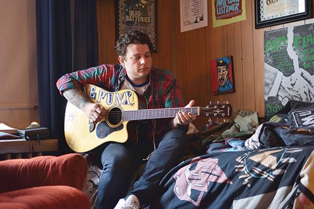 Derek Zanetti of Homeless Gospel Choir in his home studio in Hazelwood