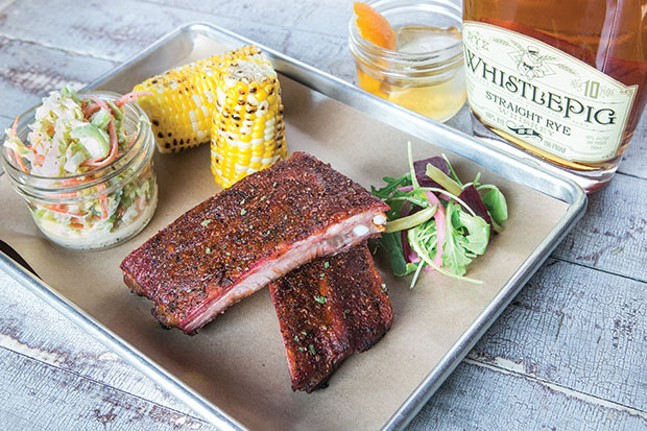 Smoked ribs with napa cabbage slaw, corn on the cob and mixed-vegetable salad