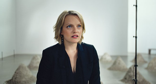 Elisabeth Moss, in The Square