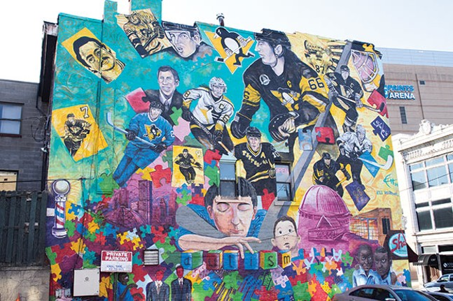 The city wants to bring more public art to Uptown, like this mural on Fifth Avenue near PPG Paints Arena, featuring the Pittsburgh Penguins and highlighting autism awareness
