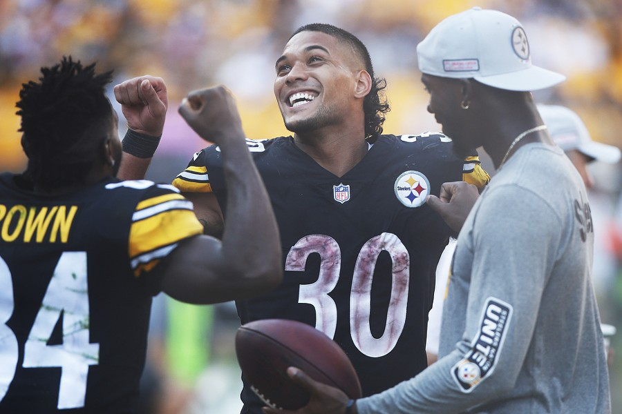 Accounting for most of the Steelers offense, Conner and Brown enjoy the game late on the sideline. - CP PHOTO: JARED WICKERHAM