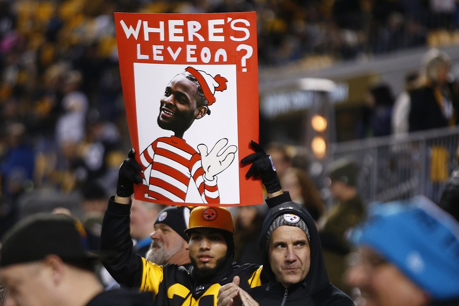 A fan holds up a sign asking, 'Where's Le'Veon?' - CP PHOTO: JARED WICKERHAM