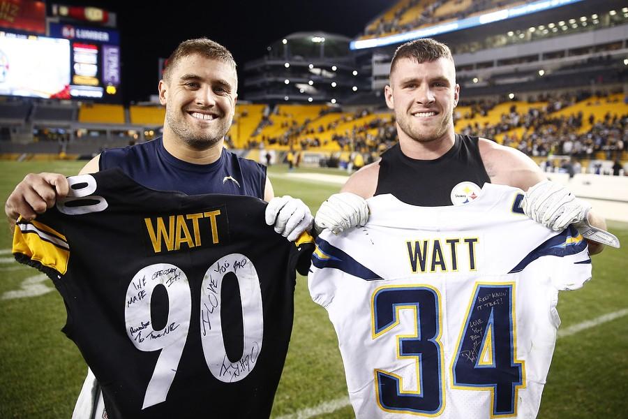 Brothers Derek Watt (left) and T.J. Watt (right) trade jerseys postgame. - CP PHOTO: JARED WICKERHAM