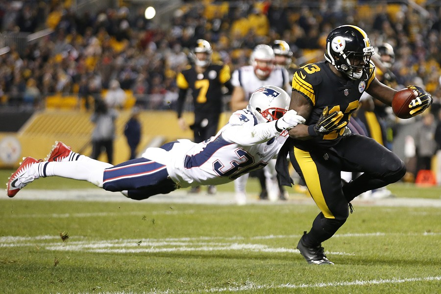James Washington evades a stretched out Jason McCourty on a catch. - CP PHOTO: JARED WICKERHAM