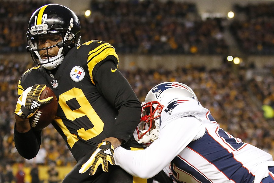 JuJu Smith-Schuster fights off a defender following a catch. - CP PHOTO: JARED WICKERHAM