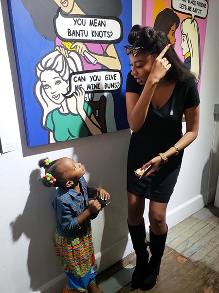 Kamara Townes, aka Wavy Wednesday, talks with her niece in front of her Barbie-inspired artwork.