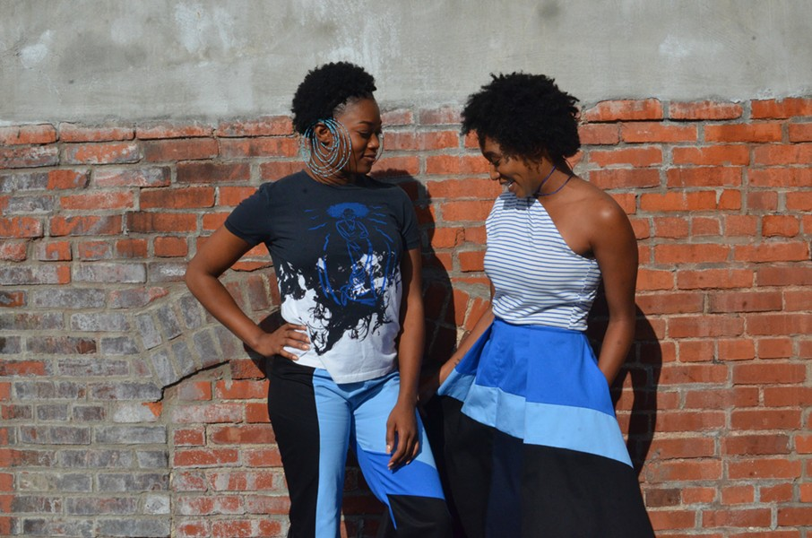 Rayne Eleese and Ronnell wearing items (with pockets) from The Blue Collection, a collaboration of Idia'Dega + OMWA + The Beading Wolves - TERENEH IDEA