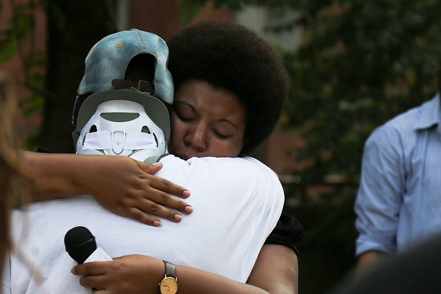 Julia Johnson consoles Tomi Lynn Harris, whose son died in custody of the Allegheny County Jail in January. - PHOTO BY THEO SCHWARZ