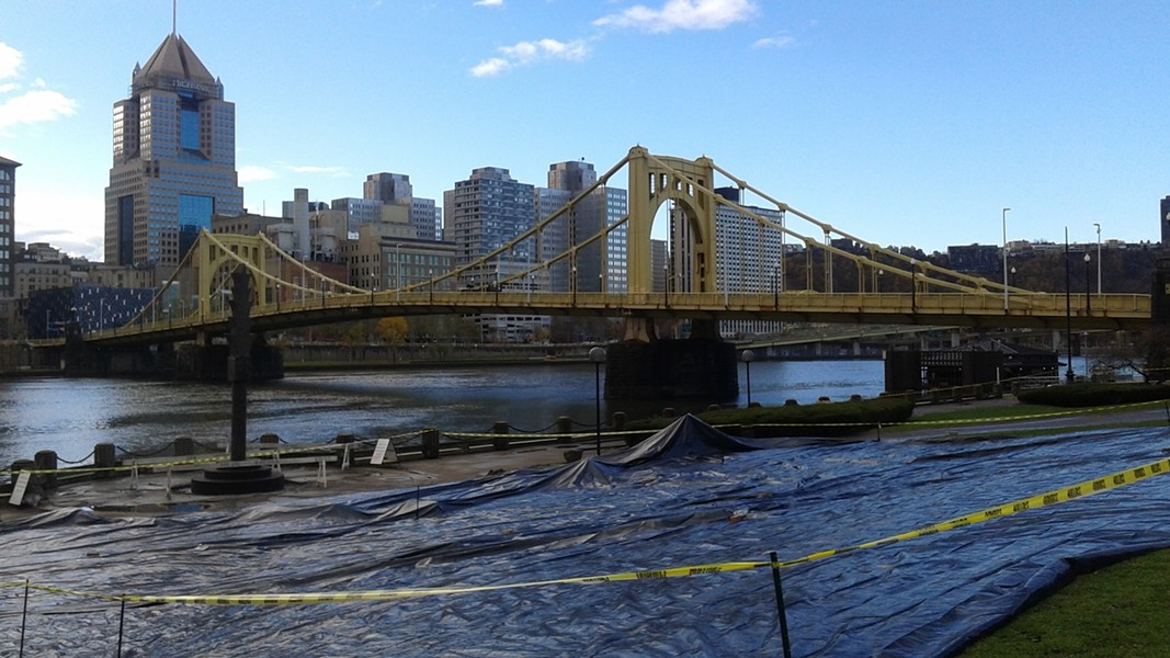Groups laid an 8,000-square-foot tarp on Allegheny Landing on the North Side to protest ALCOSAN's proposed construction along the region's river fronts. - PHOTO BY ASHLEY MURRAY