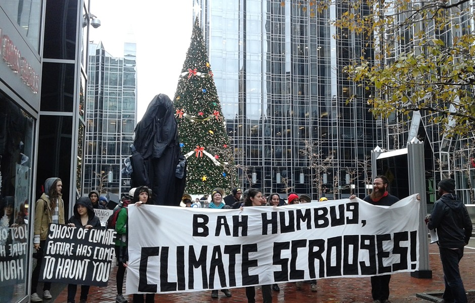 "Protesters marched with a 12-foot ""Ghost of Climate Future"" in downtown Pittsburgh this week. - PHOTO BY ASHLEY MURRAY"