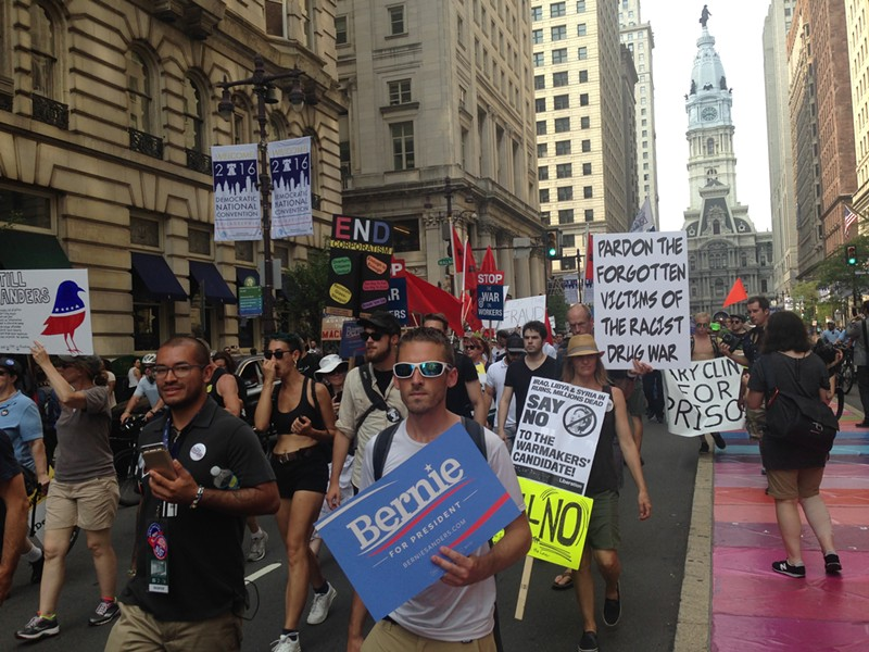 Thousands of Bernie Sanders supporters march down Broad Street in Philadelphia. - PHOTO BY RYAN DETO